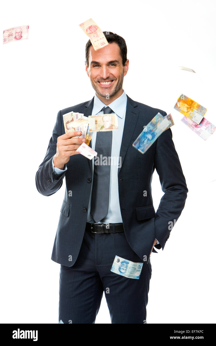 Half length portrait of a businessman smiling in falling money - Stock Image