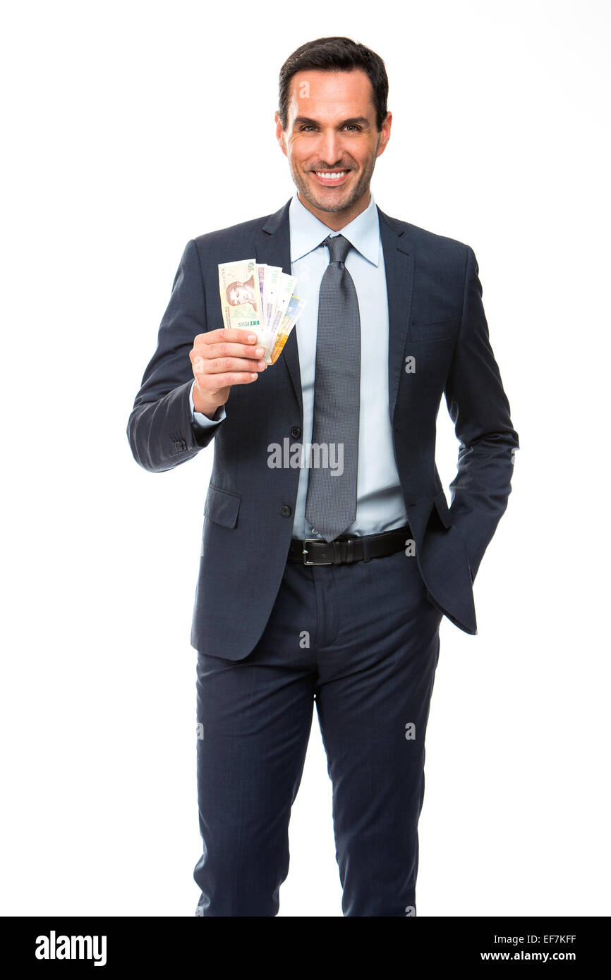 Half length portrait of a businessman smiling and holding money - Stock Image
