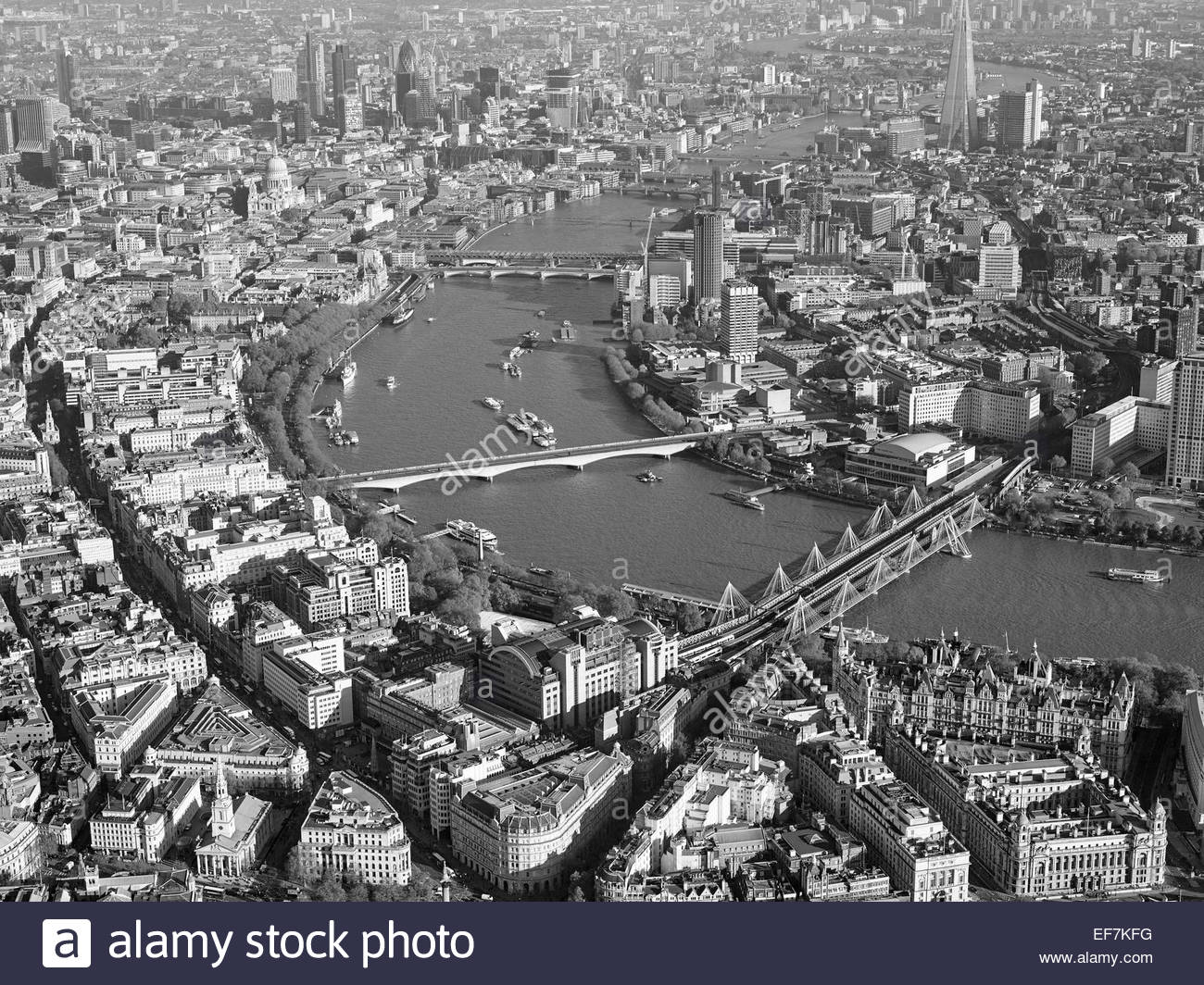 The River Thames from the air, Central London, UK looking East towards the City, Hungerford Bridge right - Stock Image