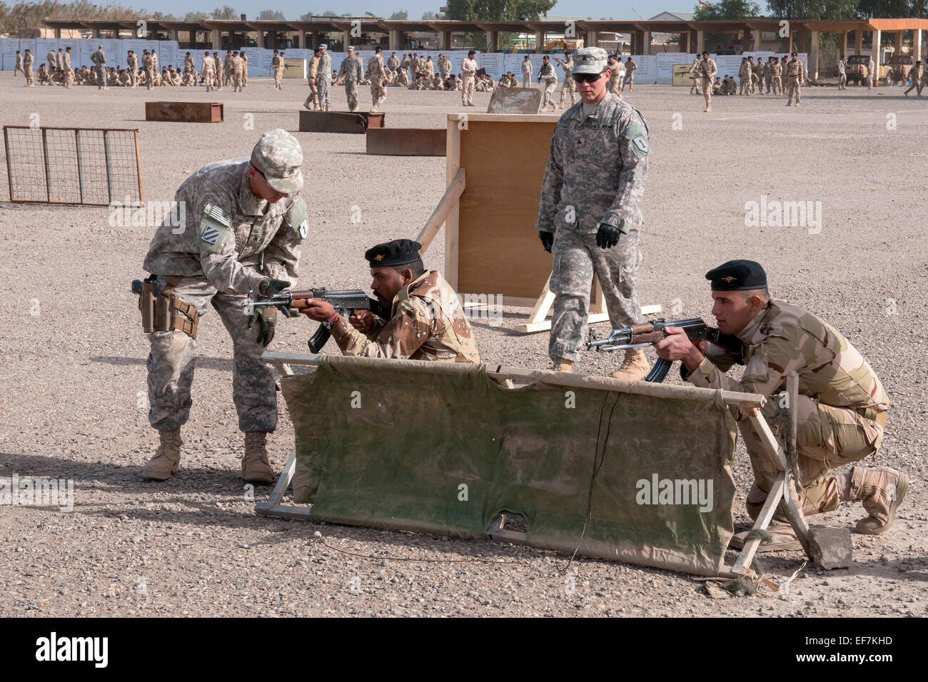 US Army trainers from the 1st Infantry Division, assist Iraqi army trainees during movement technique training January - Stock Image