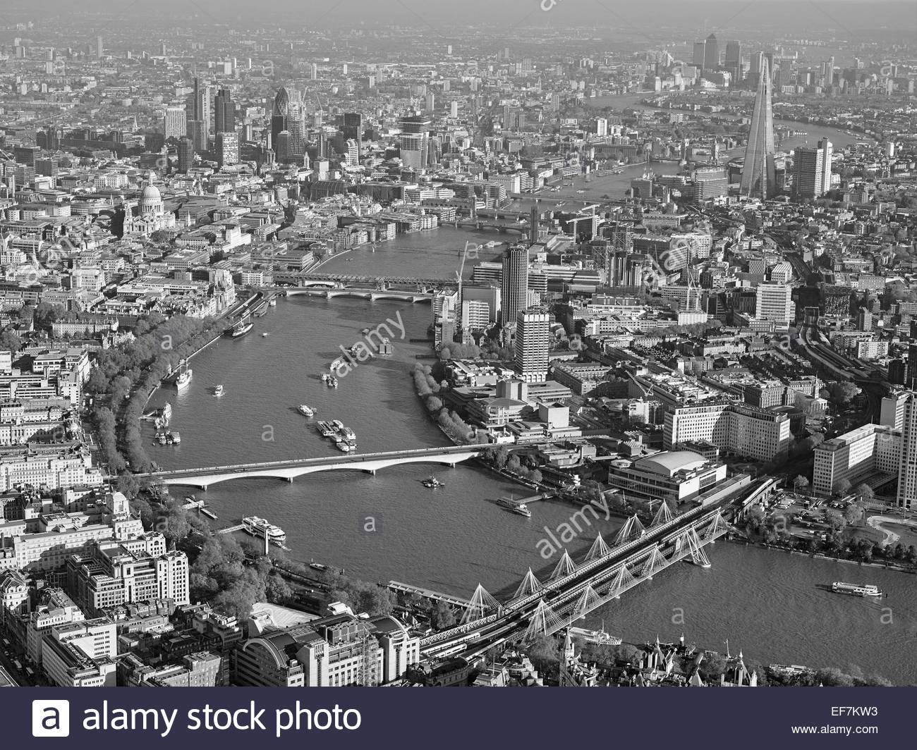 The River Thames from the air, Central London, UK looking East towards the City, Hungerford Bridge foreground - Stock Image