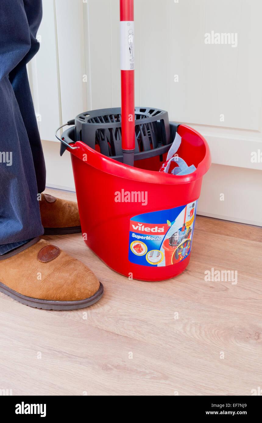 Man Using A Vileda Supermocio Mop Bucket UK MODEL RELEASED