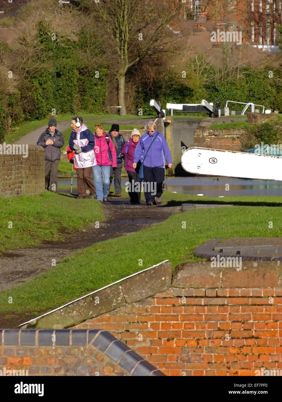 Senior Caucasian Ramblers Walking Along a Towpath at Stourbridge Canal, Wordsley, West Midlands, England, UK in - Stock Image