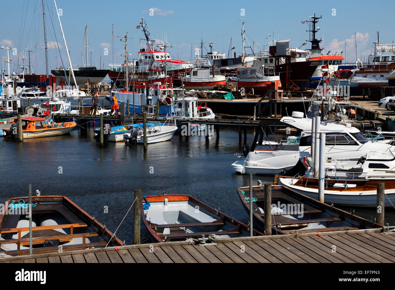Gilleleje Harbour, North Zealand, Denmark, on a warm and sunny summer's day. Shipyard and slipway in the background. - Stock Image