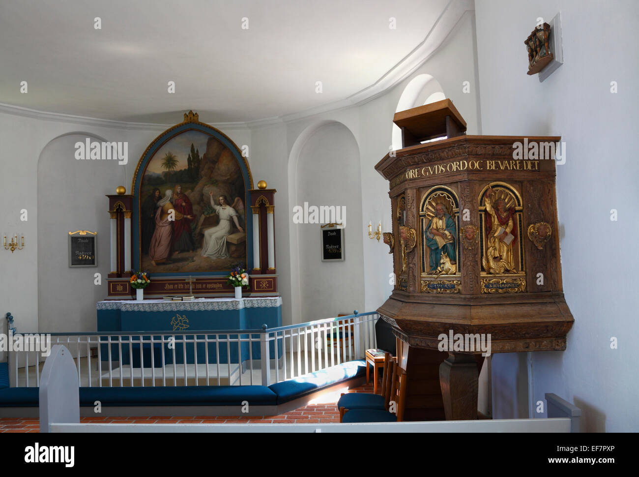 Pulpit , chancel with altar and altarpiece in Gilleleje Church, North Zealand, Denmark. Part of Jewish history in - Stock Image