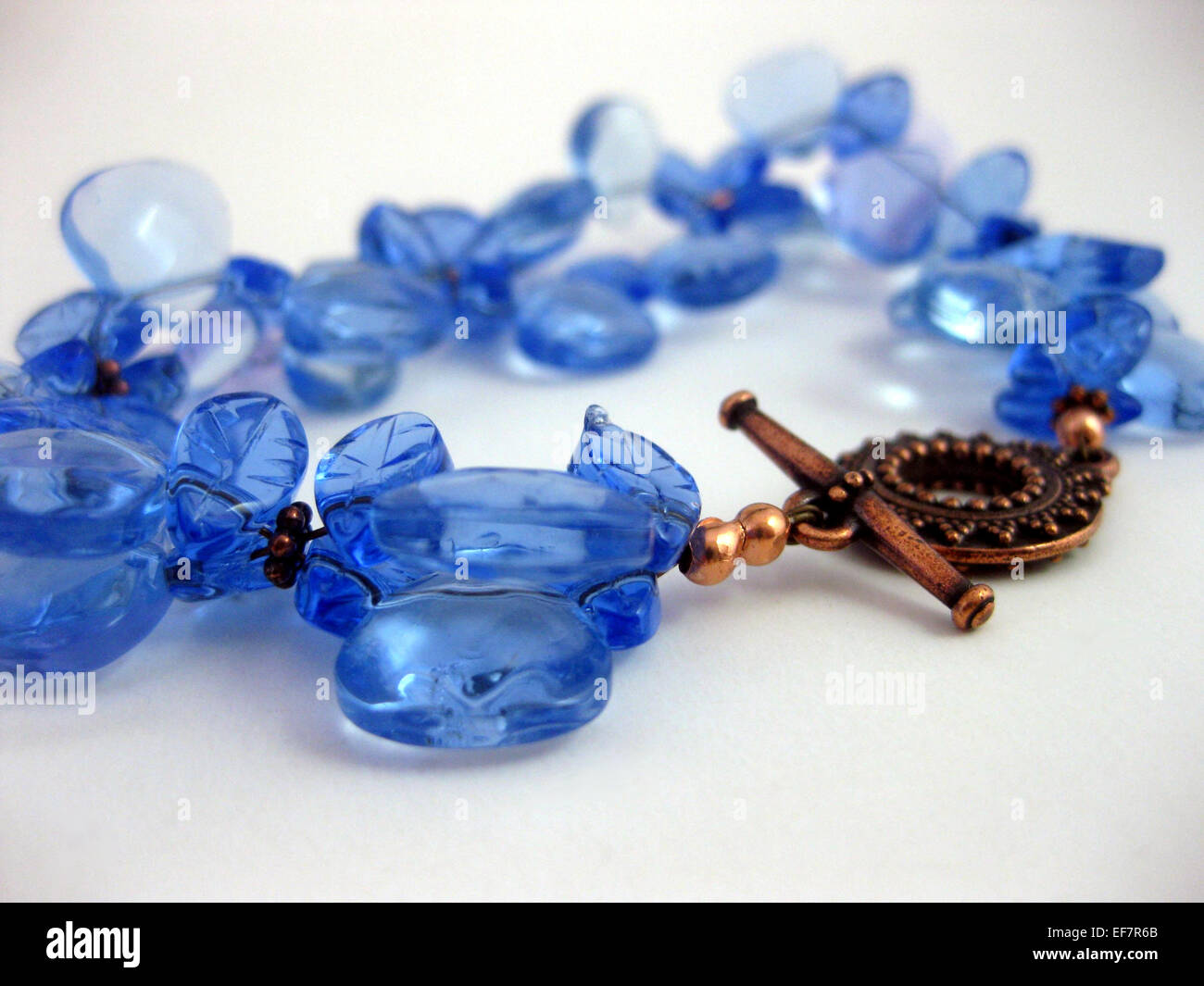 Blue glass bracelet with copper - Stock Image