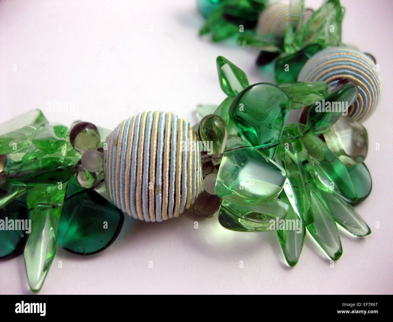 Green glass cluster necklace with cord beads - Stock Image