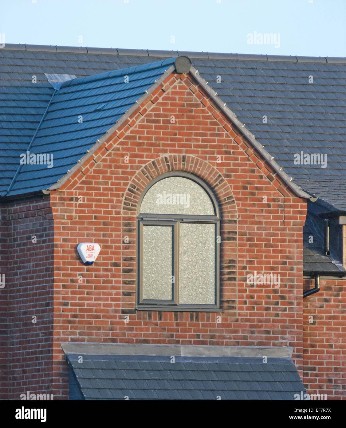 Half Moon Window on a New Build House, UK - Stock Image