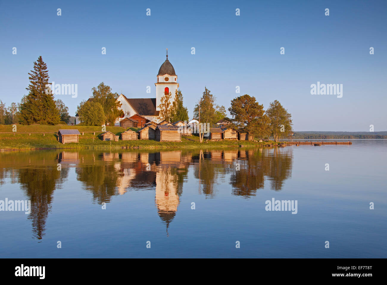 The picturesque old Rättvik Church surrounded by horse stables along Lake Siljan, Dalarna, Sweden Stock Photo