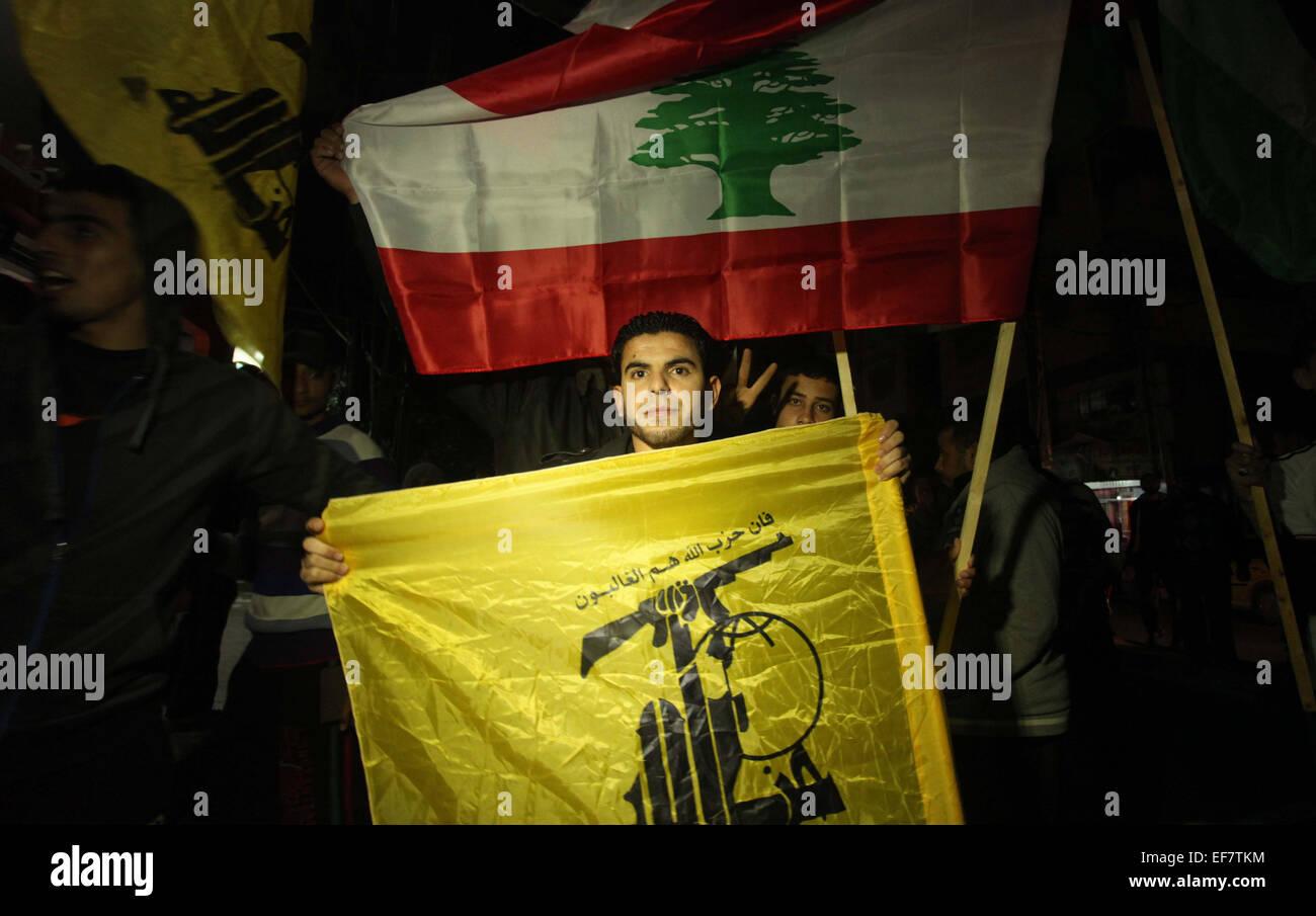 Jan. 28, 2015 - Gaza City, Gaza Strip, Palestinian Territory - A Palestinian man waves Hezbollah' flag during - Stock Image