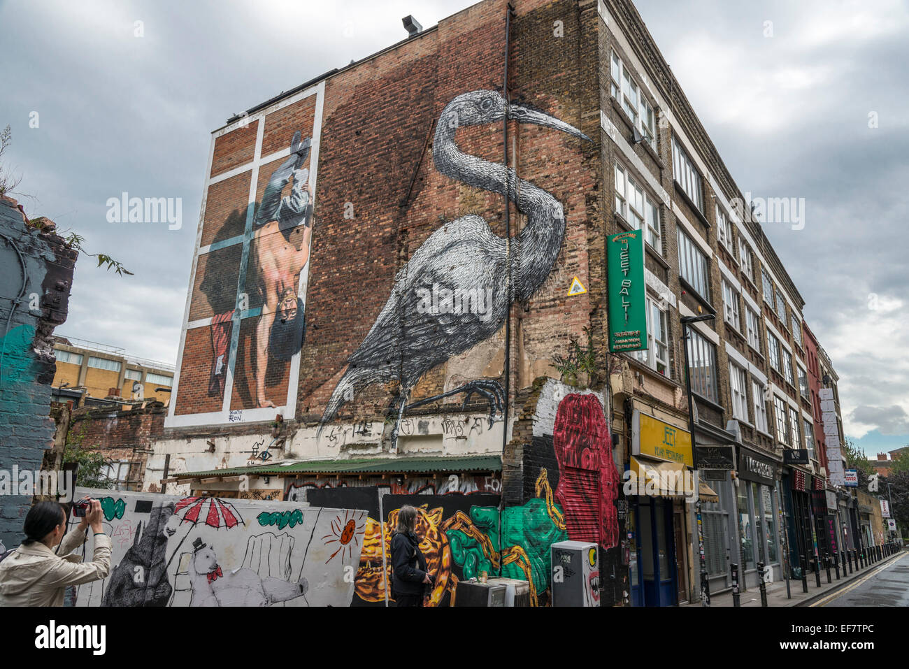 London urban street graffiti in the Brick Lane area of the city - EDITORIAL USE ONLY Stock Photo