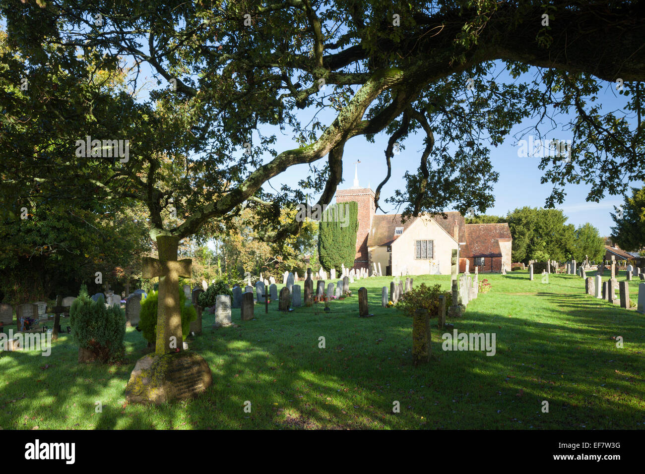 The gravestone of Sir Arthur Conan Doyle within the churchyard of All Saints church, Minstead, New Forest, Hampshire, - Stock Image