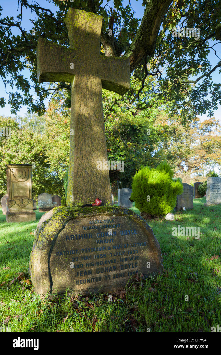 The gravestone of Sir Arthur Conan Doyle within the churchyard of All Saints church in Minstead, New Forest National - Stock Image