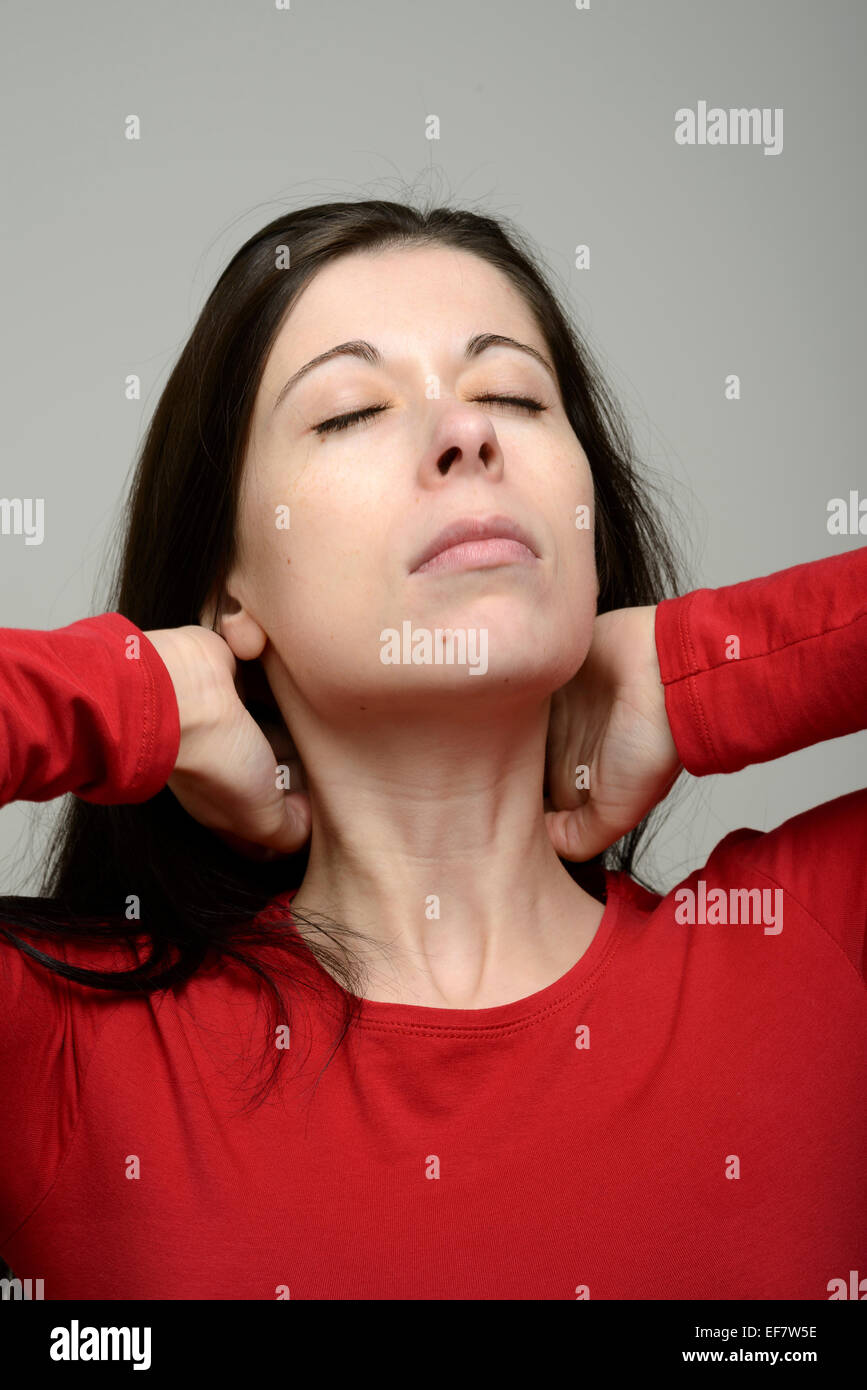 Woman suffering from neck pain - Stock Image