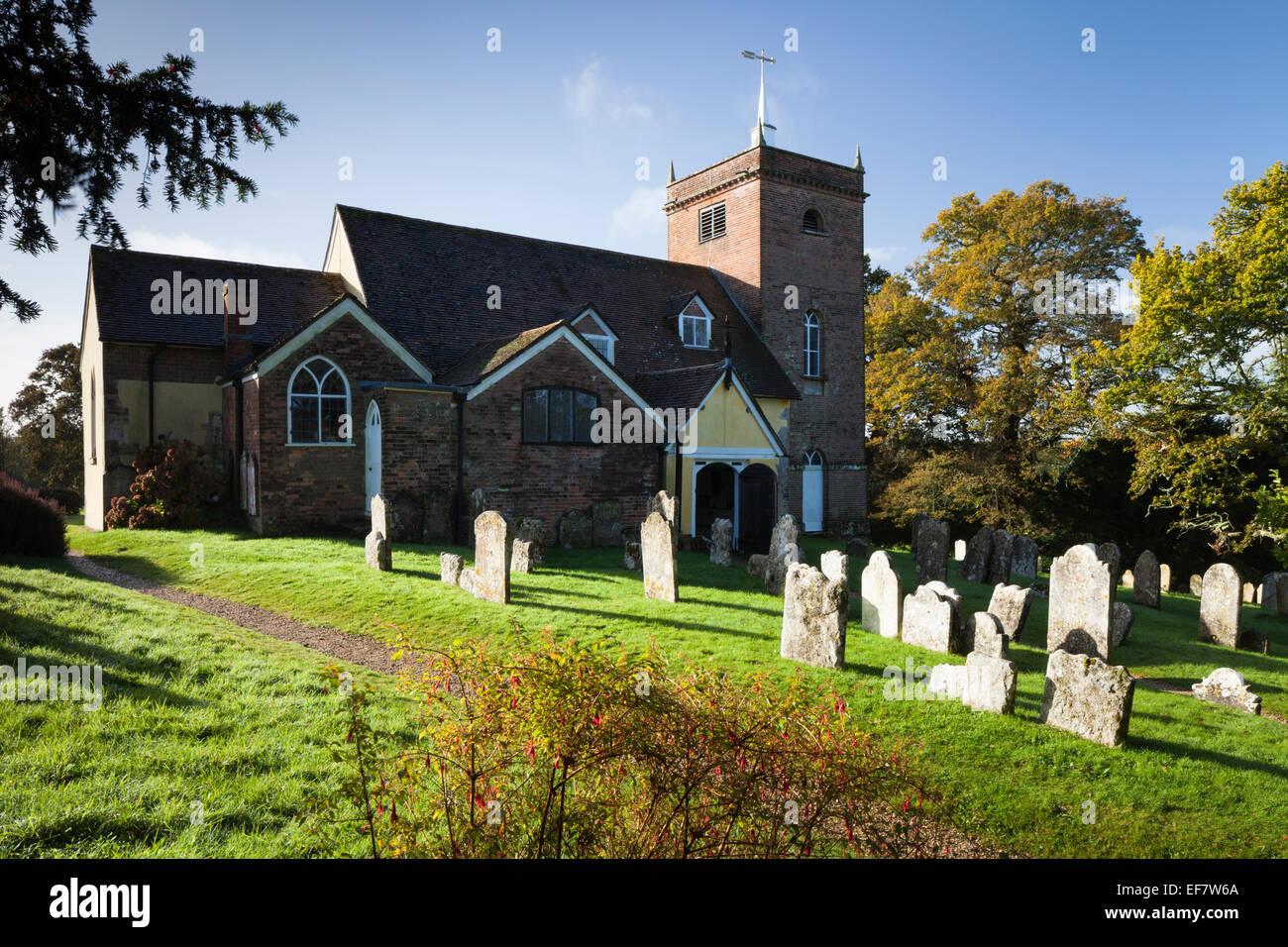 All Saints church and churchyard is where the grave of author, Sir Arthur Conan Doyle can be found, Minstead, Hampshire, - Stock Image