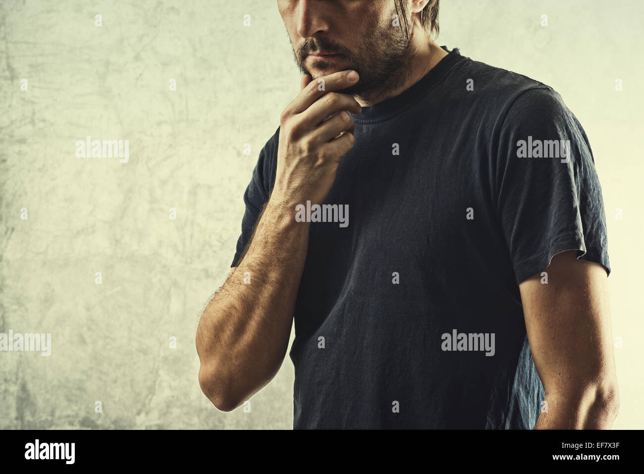 Forgetful Man Having Problems Remembering Something Important, Hand on Chin. - Stock Image