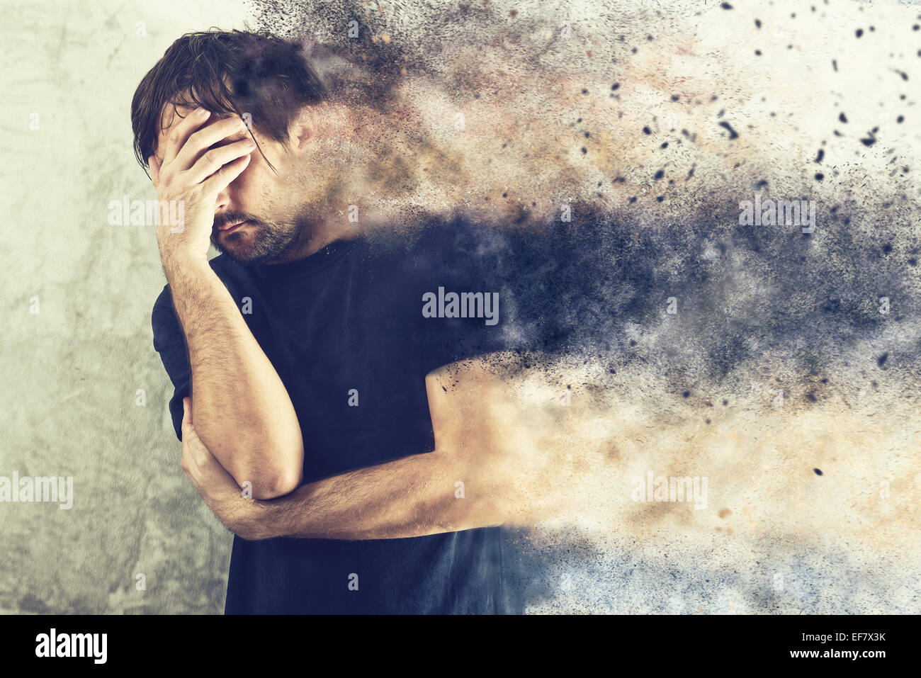 Depressed Man with Problems holding hand over his Face and Crying, occupied by Mind Blowing Thoughts - Stock Image