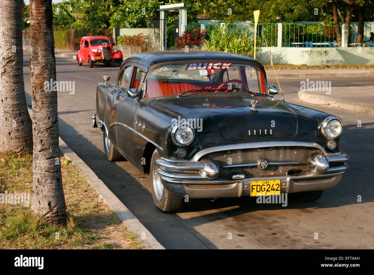 Old cars in Cienfuegos, Cuba - Stock Image