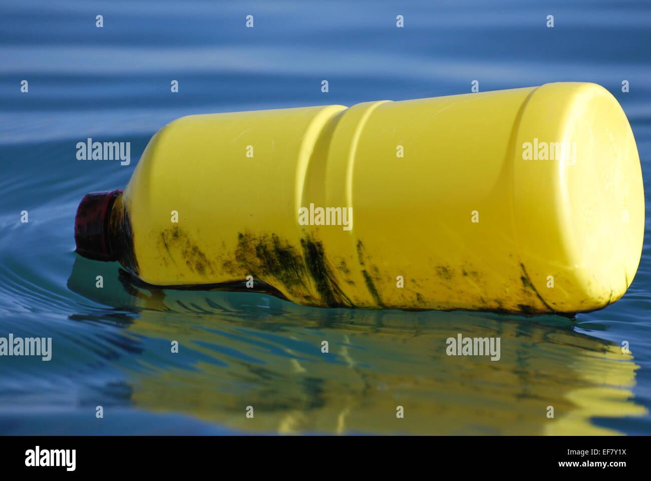 Plastic bottle floating on the sea in Dorset, UK Stock Photo