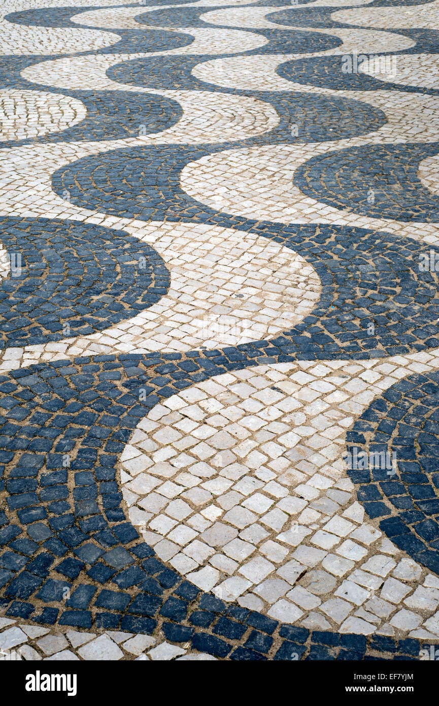 traditional Portuguese cobbled pavements with wavy lines in the coastal town of Praia da Luz - Stock Image