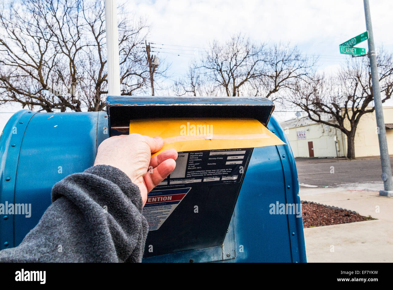 A man posting a letter at a drive up mail box in California USA - Stock Image