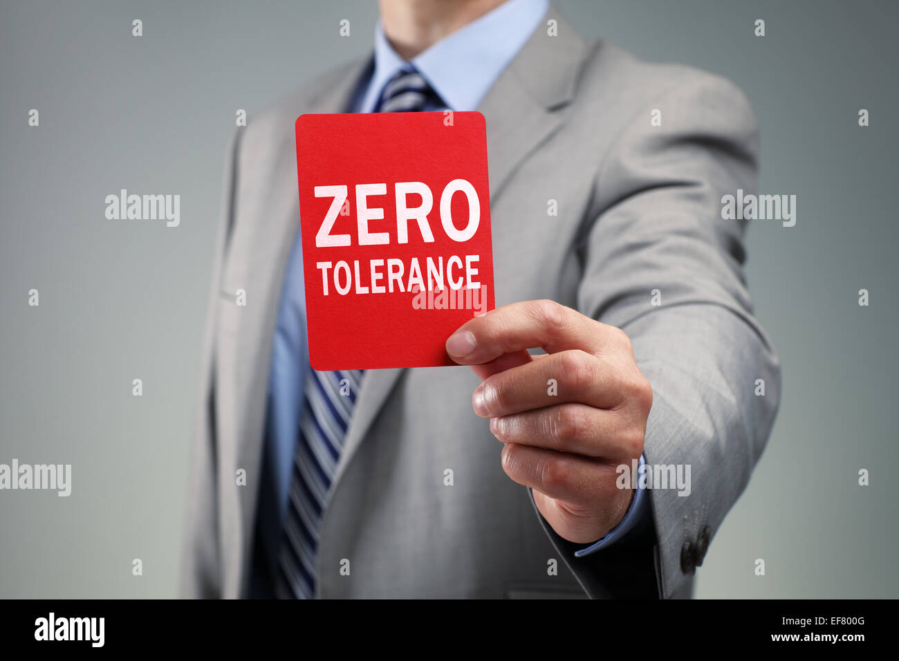 Businessman showing the zero tolerance red card - Stock Image