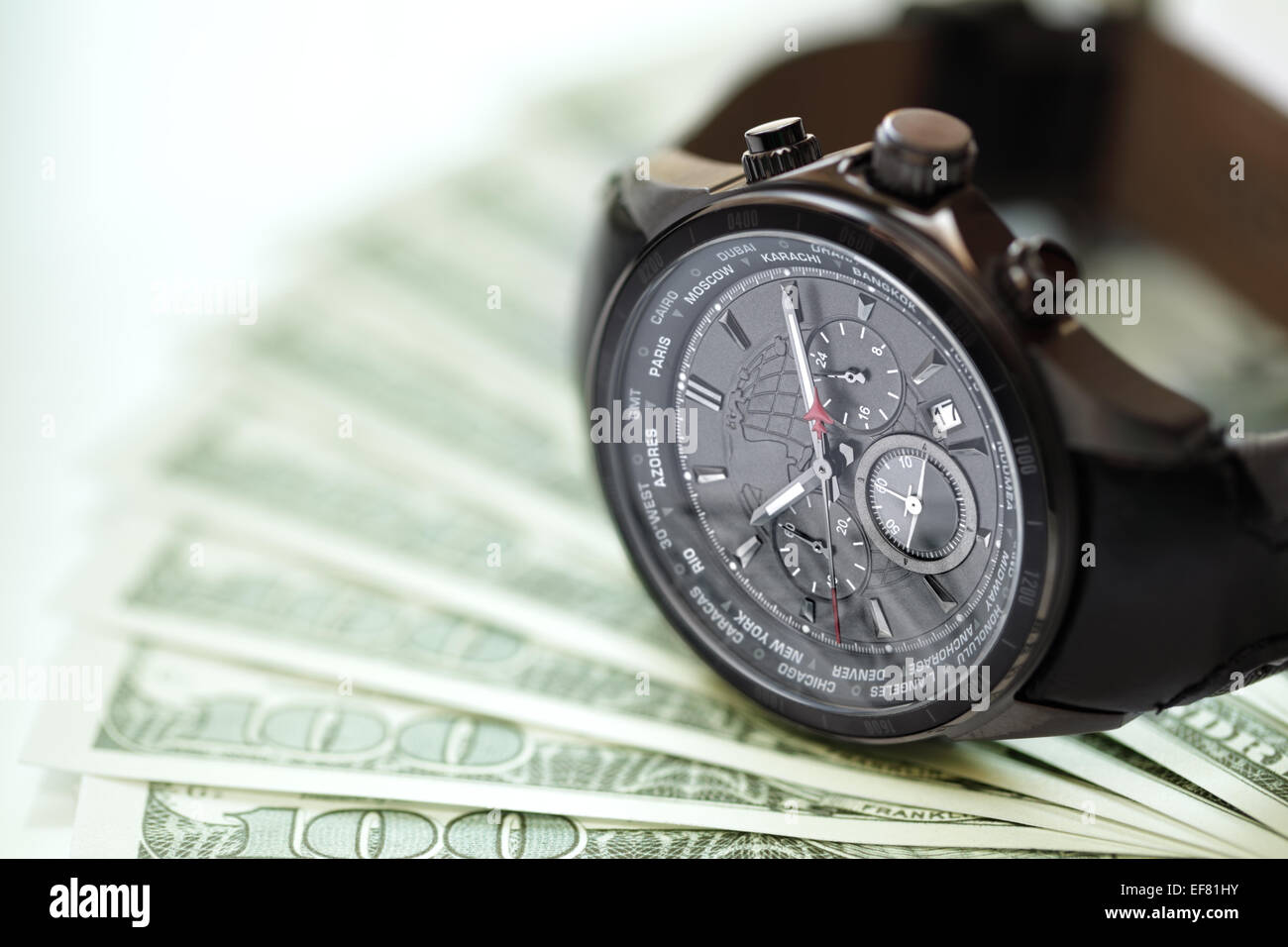 Watch and money concept for business investment or time is money - Stock Image