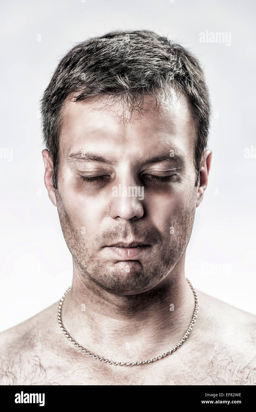 Portrait of a totally exhausted, depressed and suffering man - Stock Image