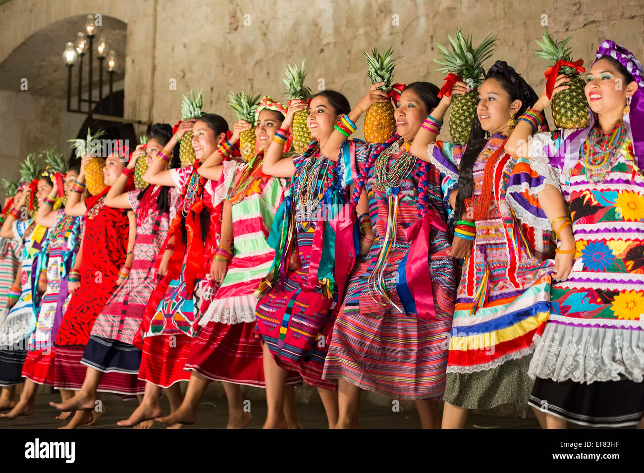 Oaxaca, Mexico - A folk dance group performs dances from eight regions of Oaxaca in the Guelaguetza Folk Dance dinner - Stock Image