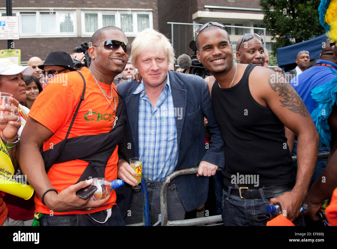 London Mayor Boris Johnson visits the Notting Hill Carnival on Bank Holiday Monday and is greeted enthusiastically - Stock Image