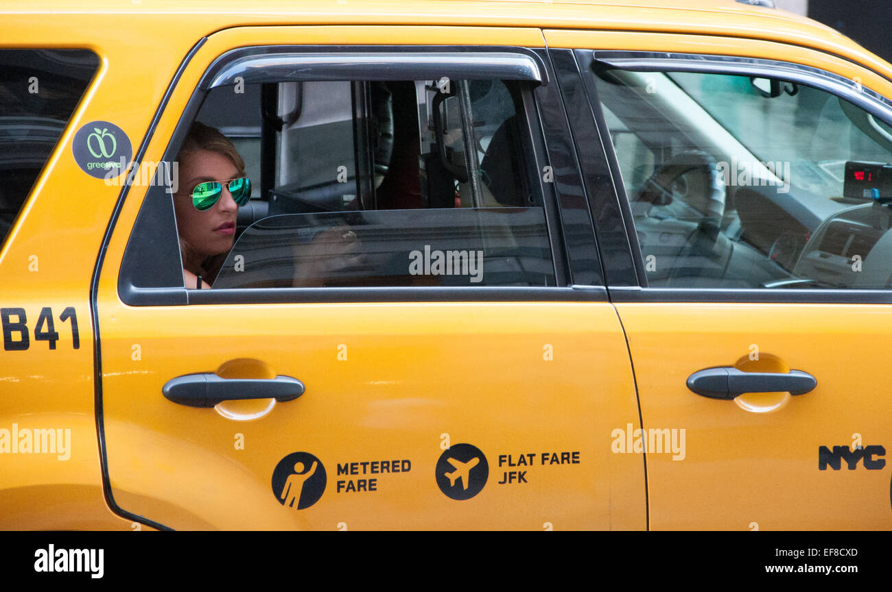 Woman in a taxi cab in New York City Stock Photo