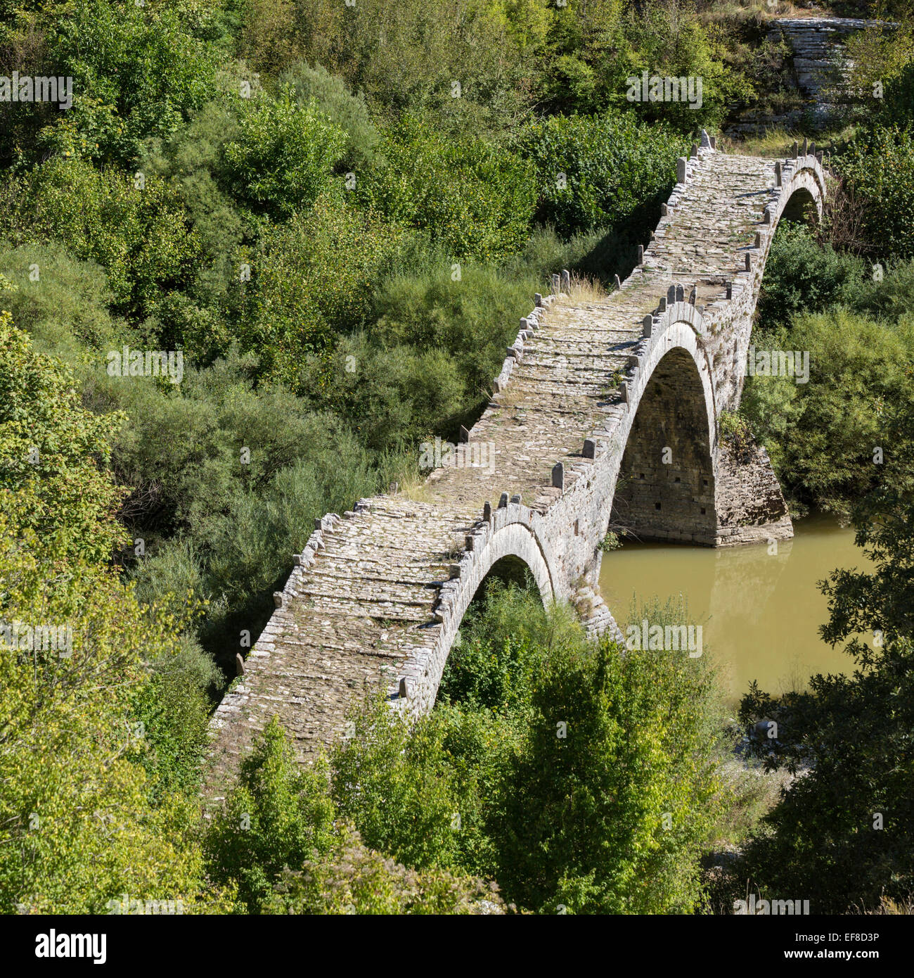 Plakida or Kalogeriko triple stone arch bridge near Kipi Greece - Stock Image