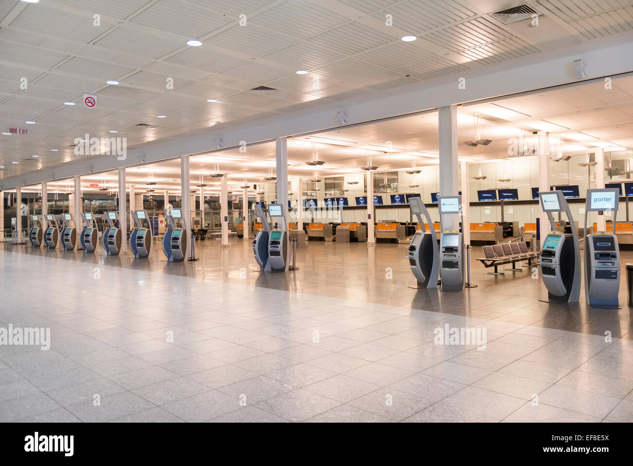 Electronic check-in kiosks at an airport in Montreal, Quebec, Canada - Stock Image