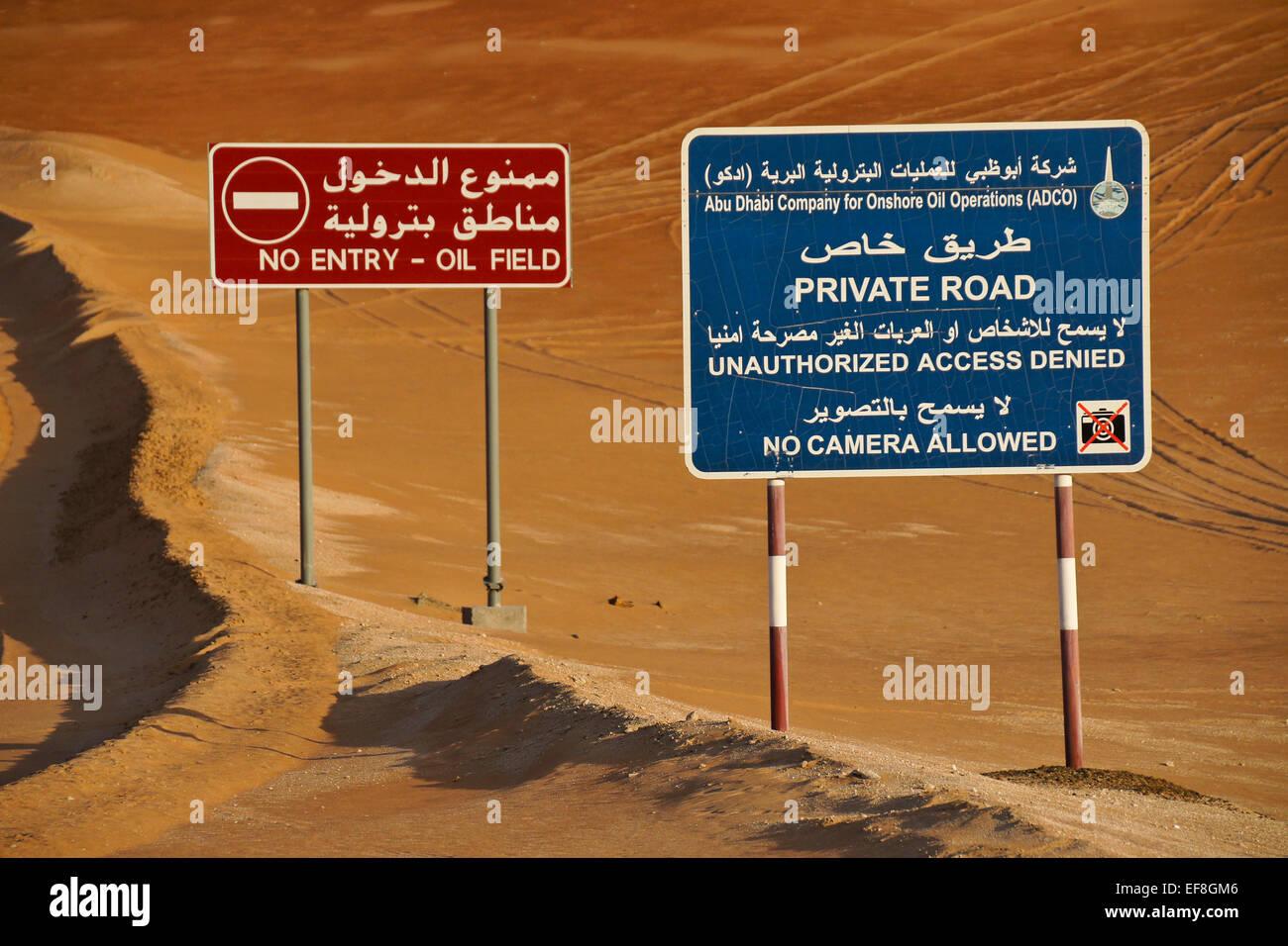 Warning signs beside road, Liwa sand dunes, Abu Dhabi, United Arab Emirates Stock Photo