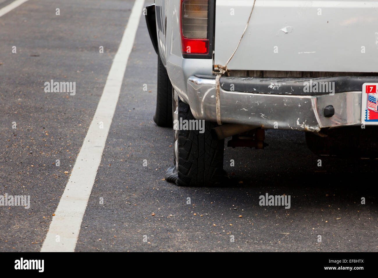 Pickup truck with flat rear tire - USA - Stock Image