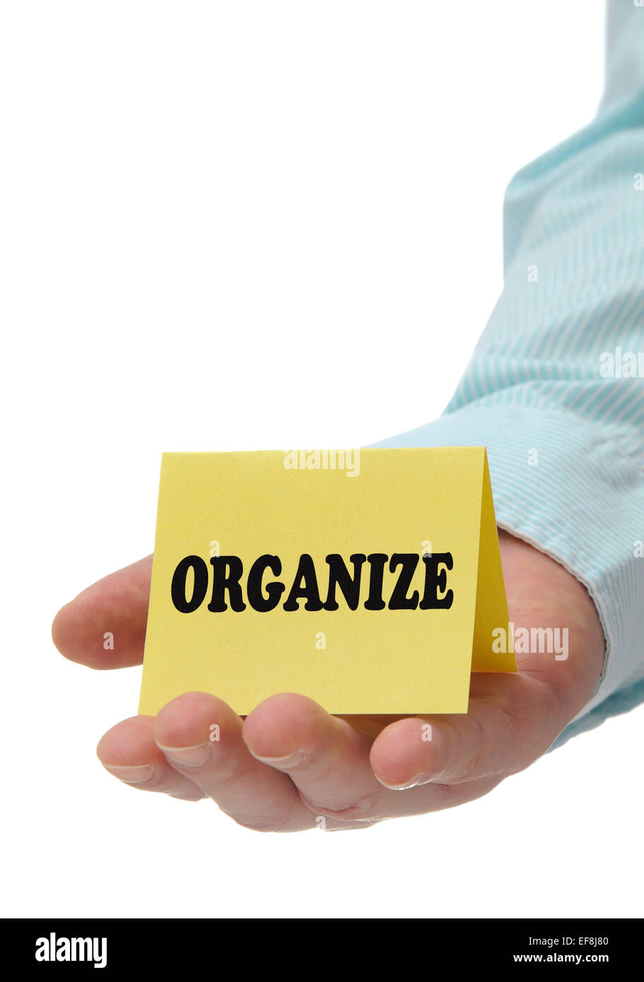 Business man holding organize sign on hand - Stock Image