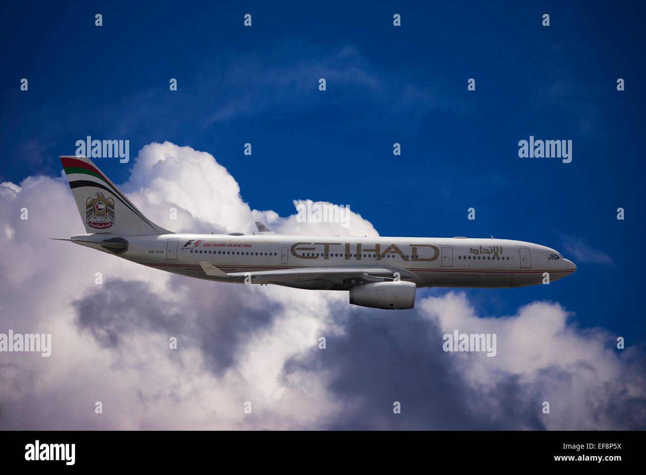 A6-EYK Etihad Airways Airbus A330-243 in flight against a cloudy sky - Stock Image