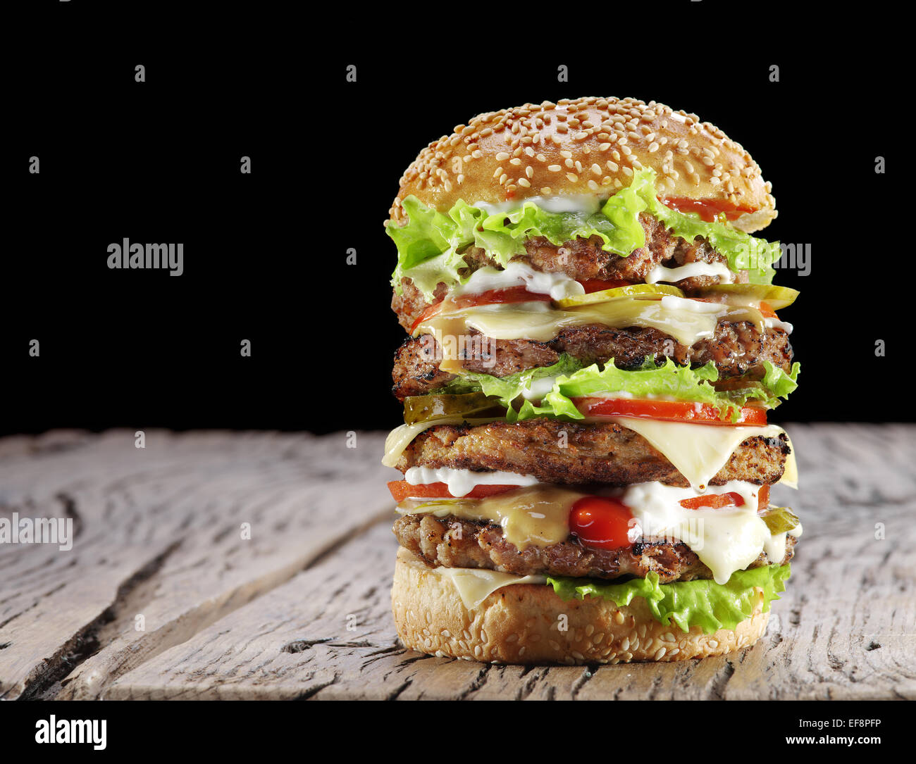 Hamburger on old wooden table. - Stock Image