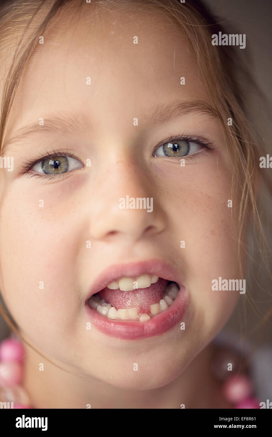 Portrait of girl (6-7) with mouth open - Stock Image