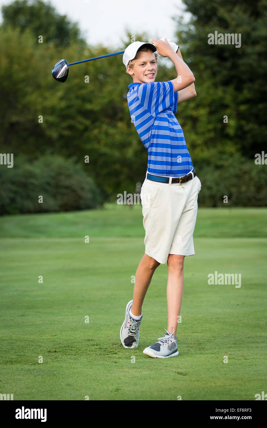 Teenage boy playing golf - Stock Image
