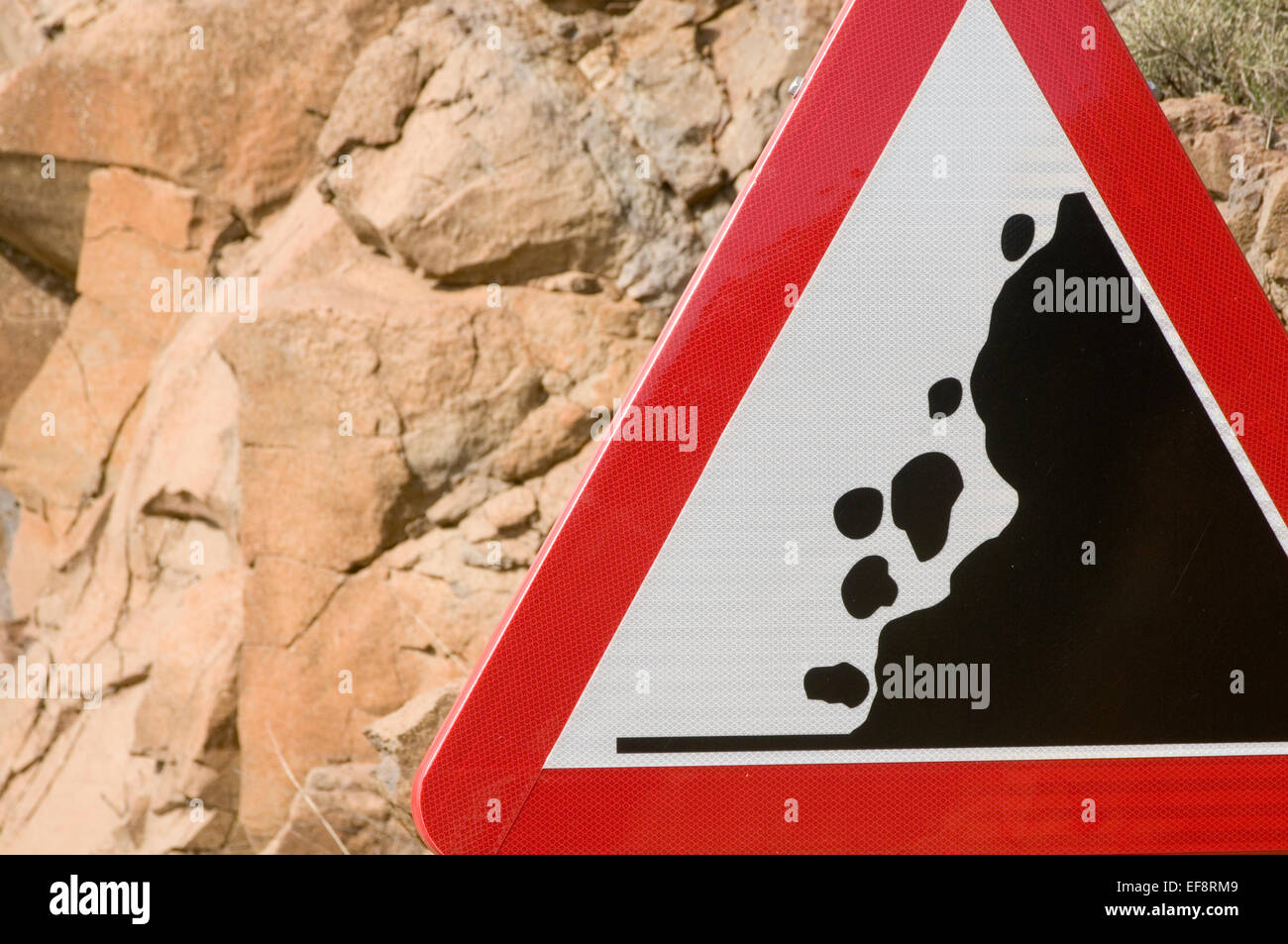 falling rock rocks road sign signs roadsign roadsigns rolling stone stones cliff cliffs  warning warn red triangle - Stock Image