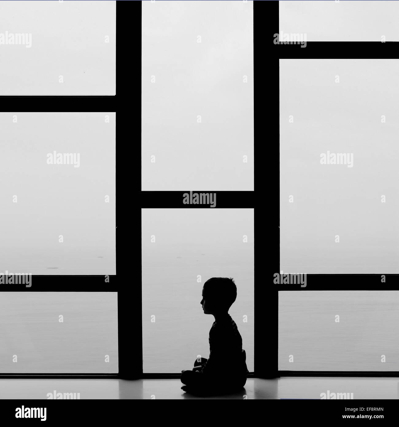 Silhouette of boy (4-5) - Stock Image
