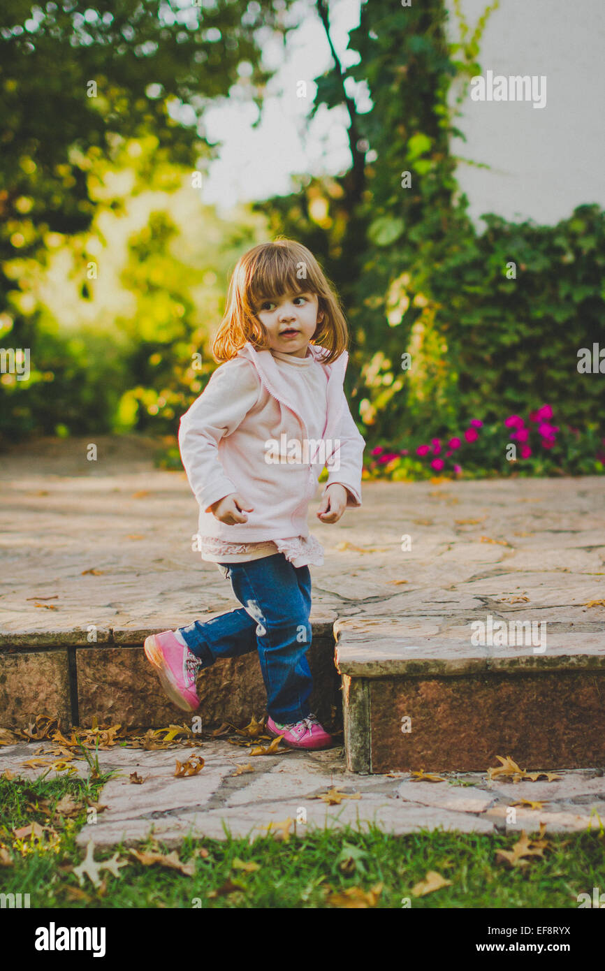 Portrait of girl (2-3) in park - Stock Image