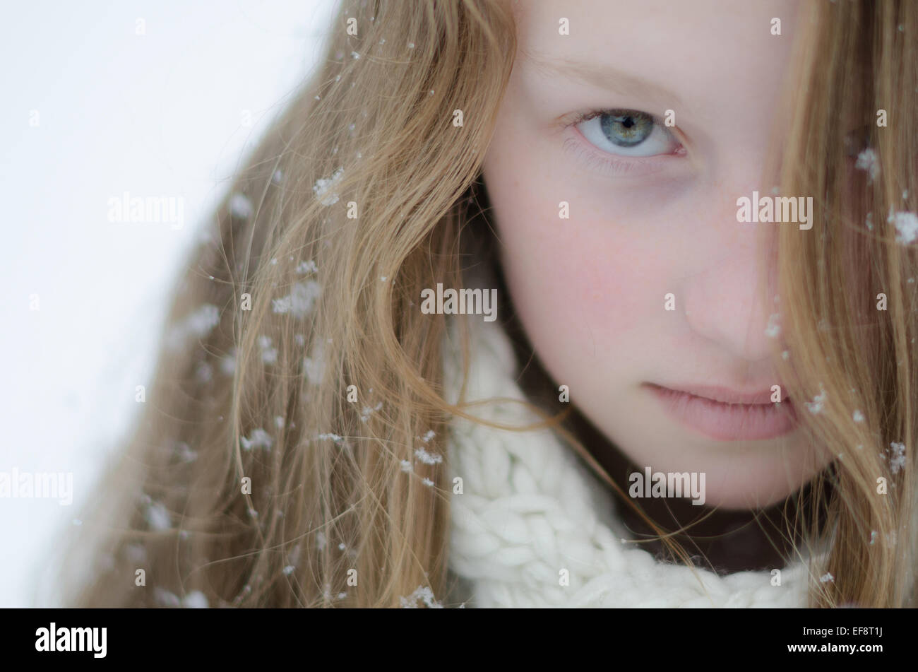 Portrait of girl (16-17) during snowfall - Stock Image