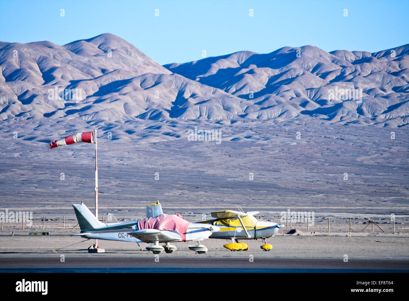 Two small airplanes at airport, Atacama Desert, Chile - Stock Image