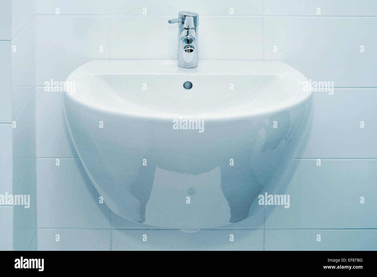 a ceramic bathroom sink - Stock Image