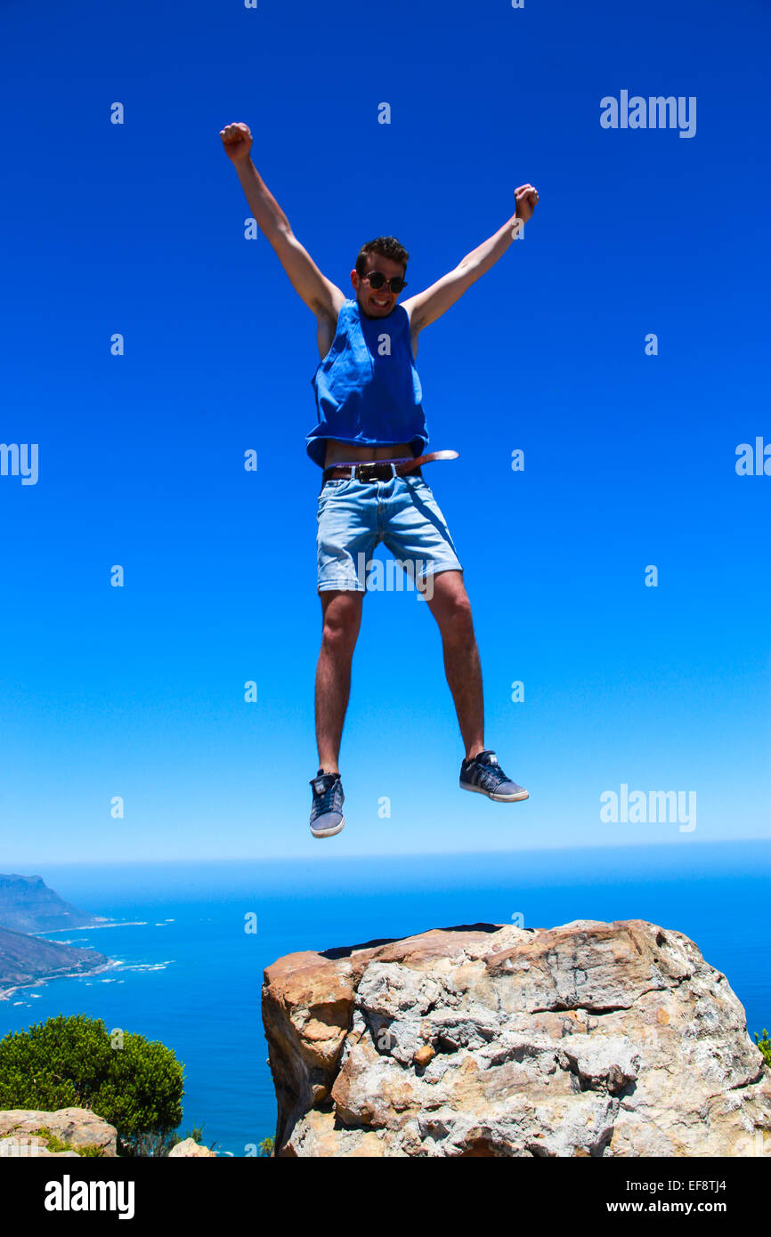 Man Jumping for joy, Lions Head, Cape Town, South Africa - Stock Image