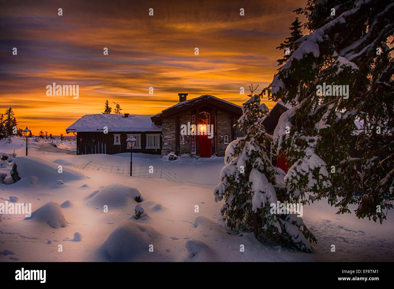 Norway, Namsos, Log cabin at sunset - Stock Image