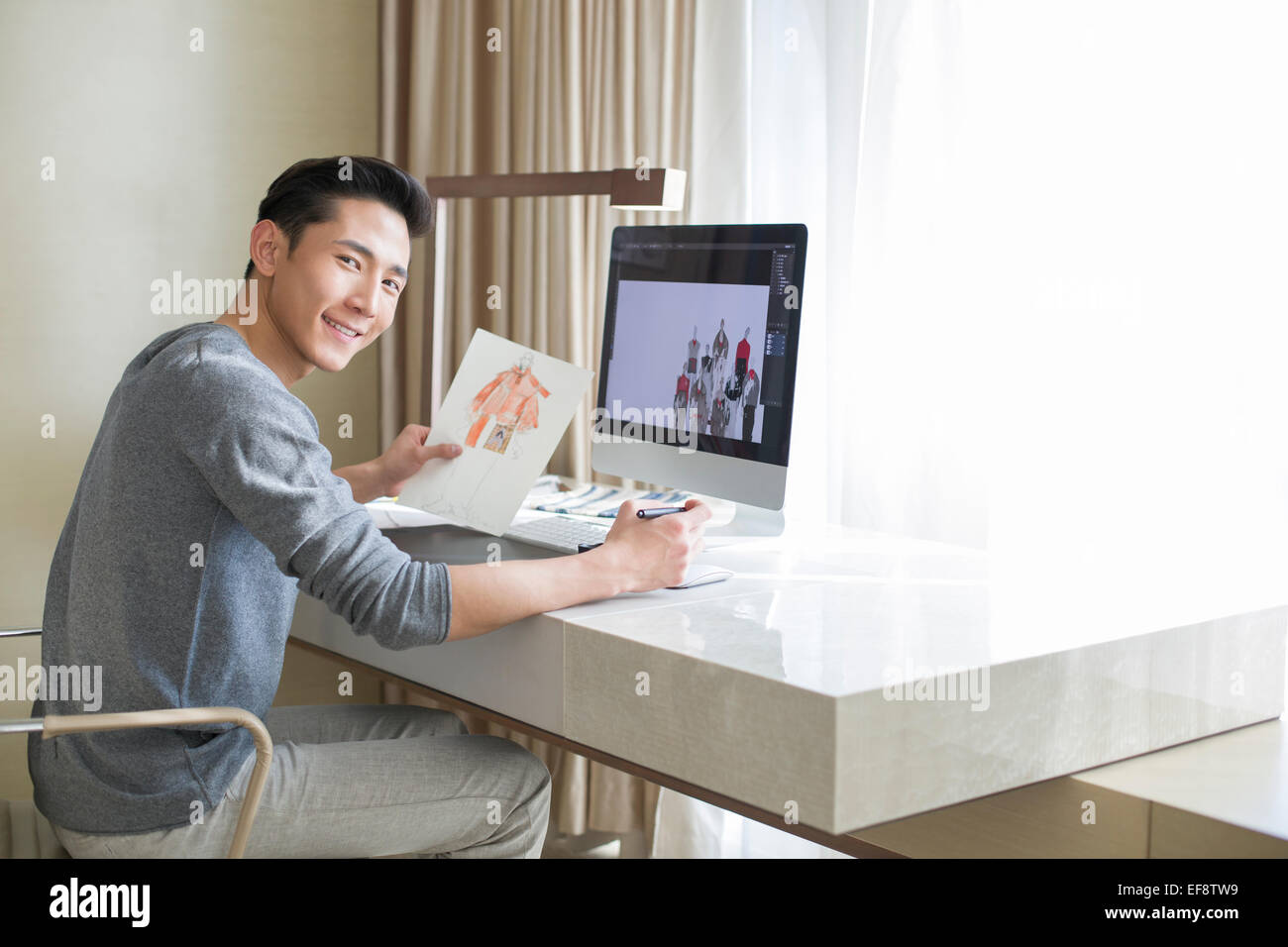 Young Male Fashion Designer Working At Home Stock Photo Alamy
