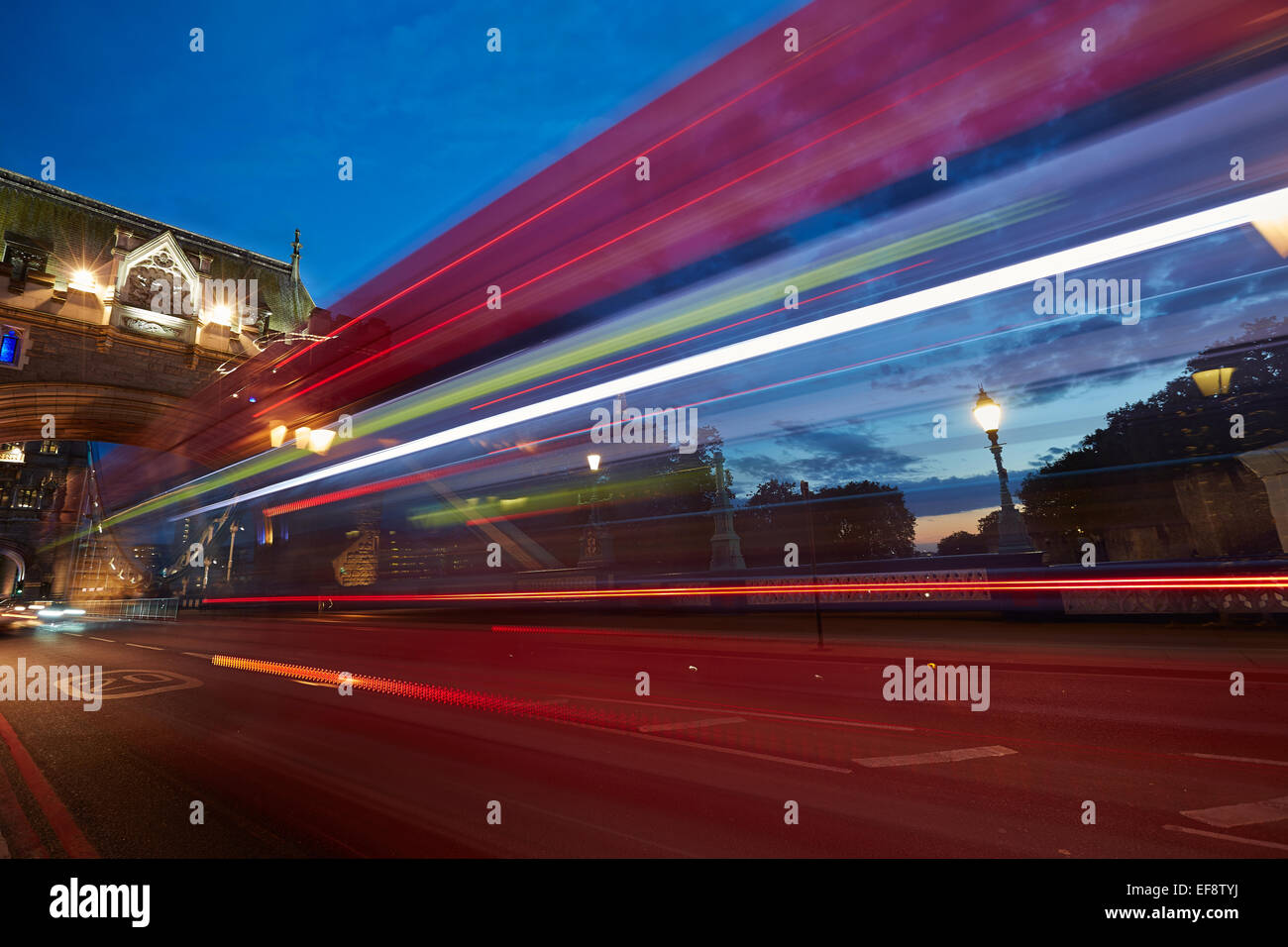 Motion blur of double-decker bus at dusk - Stock Image